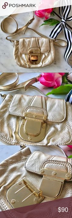 Michael Kors Charlton Crossbody Bag, Gold This luxe crossbody bag from Michael Kors is in excellent condition, featuring a large push-button closure, adjustable strap, and two large inner pockets. Small spot of discoloration (pictured), though is barely noticeable due to the placement of it! Small scratches on buckle as well, though is only noticeable when open. Only used once. Offers welcome! Michael Kors Bags Crossbody Bags