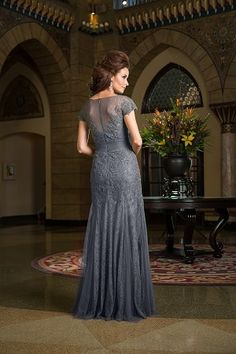 Jade Couture K168059 Leave everyone breathless at your next special event with this glamorous soft tulle gown. This A-line dress has a bateau neckline and a layer of intricate and detailed lace that wraps the entire dress.