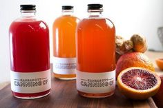 Bottles of freshly made shrubs (fruit liqueurs used in craft cocktails) are being made in small batches by Kansas City Canning Co., in Kansas City. The shrubs include (from left) Blood Orange, Apple Caraway shrub, and Spiced Pear.