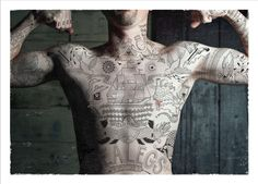 This is the best planned body art in history. Make sure to click the link and read about it.