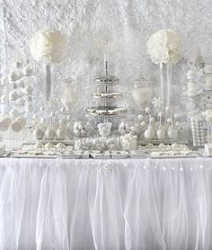all white holiday party or bridal shower dessert table