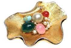 "Pearl & Multicolored Stone Gold Brooch Vintage; 1960s Condition: Very Good; surface wear on faux-pearls Materials: metal/glass Size: 2.25"" L x 1.75"" W x 0.63"" H"