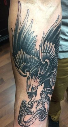 Looks like Looks like Sure, the bushy perms of the might be out of vogue, but there are plentitu Eagle Tattoo Forearm, Tribal Wolf Tattoo, Wolf Tattoo Sleeve, Tribal Sleeve Tattoos, Eagle Tattoos, Black Ink Tattoos, Black And Grey Tattoos, Traditional Tattoo Black And Grey, Traditional Tattoo Forearm