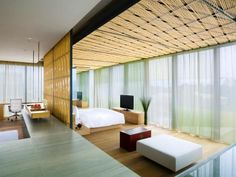 Experience bird's eye views of China's capital city in this 5,000-square-foot two-story penthouse. Light-filled rooms flow seamlessly together for the ultimate in modern urban living. Sleek wood and bamboo surfaces used throughout the space contribute to the streamlined aesthetic, while subtle touches of traditional Chinese decor lend a sense of history and place. Image courtesy of The Opposite House