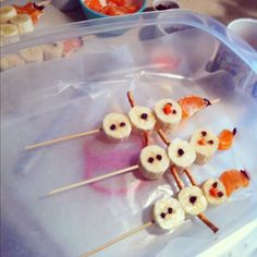 Winter snack! Bananas, pretzels, and an orange on top with a few chocolate chip decorations and you have snow men!