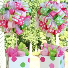 """Ribbon Centerpieces! Cut the ribbon/trims to 4"""" lengths and make loops, sticking them to a styrofoam ball with a straight pin. When the ball is covered, you stick a painted dowel rod into the bottom the ball and into a piece of floral foam that is wedged into your container."""