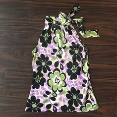 Pretty Floral Tank with Neck Tie This beautiful purple, green & black tank is perfect for work. Pair with black pants or a black pencil skirt and heels. So cute! Joy Joy Tops Tank Tops