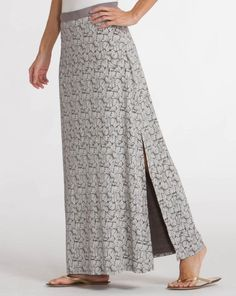 """Those who wander are not lost. The Coastline Wanderer Maxi Skirt definitely isn't aloof when it comes to chic, versatile style. Flirty side slit and coastal-inspired print anchor this maxi skirt, making it a homerun look year round. <em> thin, dyed to match flat elastic waistband, long side slit on left side, skirt lined to low hip, 92% Rayon, 8% Lycra blend, Made in USA</em></p>  Model dress size: 6 Model height: 5'11"""" Size on model: Small"""