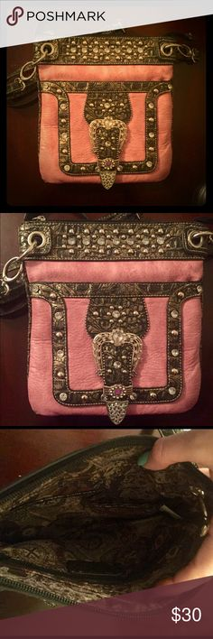 Pretty Pink Cowgirl Crossbody Purse This purse is really pretty, and has been used a number of times. Does not have any stains or scratches and is not missing any of the adornments on the front. Has plenty of pockets for storage that close with zippers and magnetic clasps. Does have a small hole in the fabric on one of the inner pockets, this isn't visible. Bags Crossbody Bags