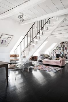 A single track stair case that sits in the middle of a room w/o interfering w/space/flow.
