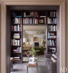Love the book shelf over the doorway thing. I wish I could do both sides down on either side of the door, unfortunately, due to layout, I can only do one side.