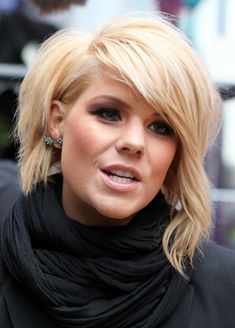 Layered short haircut with long, asymmetrical fringe and noticeable volume over the crown.
