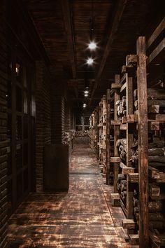 cadena+asociados' rustic 'carboncabron' grillhouse uses thousands of wood logs