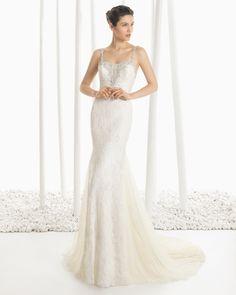 DOGMA vestido de novia en encaje pedrería con bordado de pedrería en color marfil.