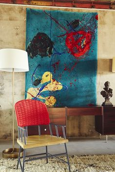 Abstract art with side chair and brass floor lamp