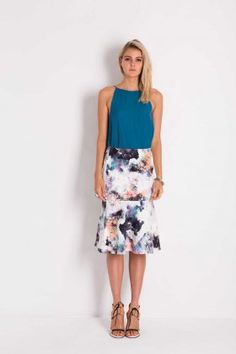 Midi+length+fit+and+flare+trumpet+skirt+made+from+a+engineered+stretch+based+fabric.+Model+wears+size+8.