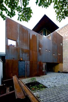 Weathering steel panels create rusty walls for family home in Oslo's old town