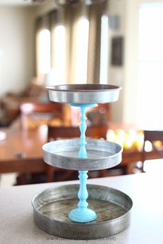 Tiered storage/display::: made from old round cake pans and two spray painted candlesticks @cidneym we used something similar to this for appetizers and cupcakes at the wedding!