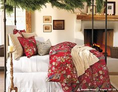 Bedroom: Wonderful Bedrooms in Christmas Decorating Themes, Interesting Christmas Touches for Bedroom showing Beautiful Red Floral Comforter and Throw Pillows also Green Garland Decorated on Canopy Bed Frame and Mini Fireplace Mantel Ornaments