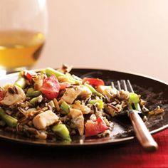 """Chicken Wild Rice Salad Recipe -""""I modified a recipe I received years ago and came up with this versatile salad. It's refreshing served cold on a hot day, but its equally tasty at room temperature or warmed in the microwave."""" —Robin Thompson, Roseville, California"""