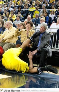 Michigan's Governor Rick Snyder was this close to getting kicked in the face during a basketball game. I believe the player was from Flint...