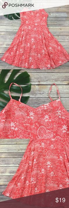Old Navy coral orange boardwalk print sundress Old Navy coral seaside scene print sundress, size S. It is free from any rips or stains. It measures about 34 inches around the bust, about 29 inches around the waist and is about 36 inches long. Old Navy Dresses