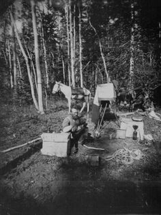 John K. Hillers at work with his negatives. In camp, Aquarius Plateau, Utah Terr. Hillers was a photographer with the John Wesley Powell Geological Survey.
