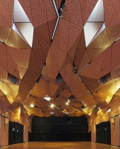 """At the University of Technology in Sydney, DRAW dramatically transformed a formerly lifeless ceremonial space into an attractive core that reflects the institution's dedication to design innovation. A fluid layer of perforated aluminum, aptly titled the """"Mantle,"""" clads both ceiling and walls, providing lighting, audio-visual, fire, and mechanical systems, all while enlivening the interior with a unique geometric atmosphere. #architecture #design #interiors #interiordesign #sydney…"""