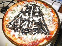 "Darth Vader Pizza (with olives) | Via: Bit Rebels (from ""Geektastic Collection Of Star Wars Inspired Party Foods"") 