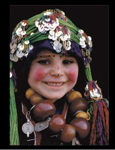 Africa |  A young Berber girl. Morocco, Haut Atlas, Imilchil, young Berber girl of Ait Haddidou tribe during the Wedding Moussem (festival)