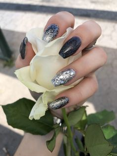 Rock inspired nails with glitter and gun metal. Made by @dnze