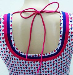 Where can I find a seamstress to design a top for me ?
