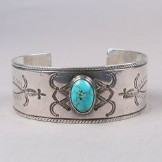 Stamped silver cuff with turquoise stone c. 1910