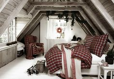 Maik Rositzki:::Interior   stillstars.com wood paneled attic bedroom. I love the plaid, but I could do without all of the plants and stark white accent wall and floor.