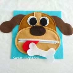 Dog zipper mouth page. Dog face with zipper mouth. Tongue is sewn inside mouth (not removable, but can be rolled/folded up to close the zipper).