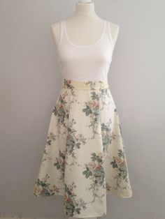 A personal favourite from my Etsy shop https://www.etsy.com/uk/listing/289709859/cream-floral-pleated-skirt-vintage