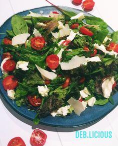 Salad with tomato, mozarella and parmasan cheese