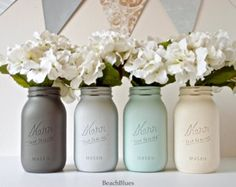 These beautiful wide mouth quart size mason jars are hand painted for a beachy, cottage chic feel. They are perfect for fresh flowers and water. They make beautiful centerpieces for your wedding tables or your home decor. This listing is 4 jars for $32. The colors are dark grey, turquoise, aqua and light grey. The jars are 6 1/2 tall and 3 wide at the mouth. I pride myself in creating unique colors and styles of painted and distressed shabby chic mason jars. Beach Blues is the home of the…