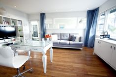 BRAMBILA salon -Droplets paint color Dunn Edwards Sofa, wall unit, Barbara Stock Interior Design