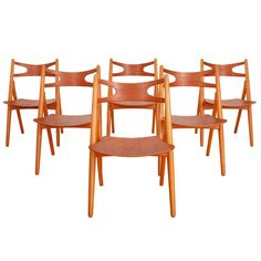Hans J. Wegner Sawbuck Chairs | From a unique collection of antique and modern dining room chairs at https://www.1stdibs.com/furniture/seating/dining-room-chairs/