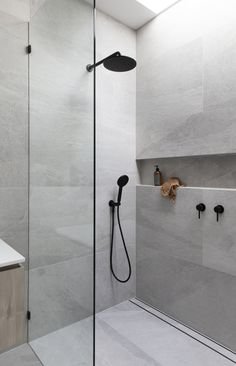 Using large tiles in your bathroom shower is easy, and you can avoid numerous tile cuts.
