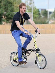 Prince Harry cycles between venues on a Brompton bike during the Invictus Games at Queen Elizabeth park on 12.09.2014 in London, England.