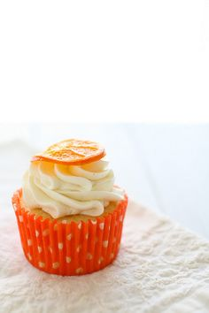 Orange Vanilla Bean Cupcake - topped with vanilla bean frosting and candied oranges. Perfect.