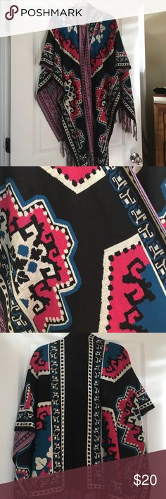 Aztec print poncho Trendy fall/winter tribal printed knit poncho. Size m/l. Like new, never worn. Can be belted at the waste! Super cute with jeans or leggings. Flying Tomato Jackets & Coats