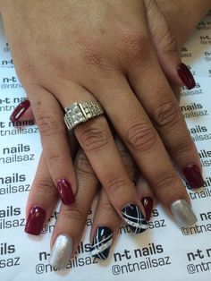 Red nails with black and sillver gel set.