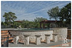 Spanish style decor is brought outdoors to this hill country hacienda style home. Featured here is Recinto Cantera Stone tile and Old World Saltillo tile pavers around the swimming pool. #rusticotile #mexicantile #rustic #spanish #outdoors #outdoorliving #landscapearchitecture #architecture #stones #Coping #swimmingpools #pool #summerheat #texas #hillcountry