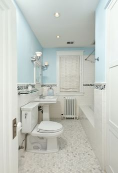 white and light blue bathroom tile clean and fresh looking