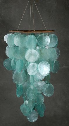 Save on CraftsBreakfast at Tiffany Blue Light decorTurquoise capiz Wind Chime but can turn into chandelierCoastal Living Wind Chime - is it made from sea glass or Capiz shells?Turquoise Wind Chime I have these shells - would make a beautiful hanging Capiz Shell Chandelier, Hanging Chandelier, Shell Lamp, Beachy Chandelier, Chandeliers, Shades Of Turquoise, Aqua Blue, Purple, Turquoise Color