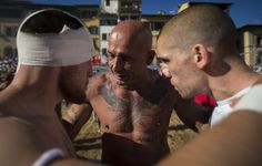 The Santo Spirito Bianchi players bond before the start of the for the final which lasts for 50 minutes. The Calcio Storico, the most brutal sport on earth – in pictures