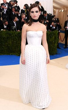 Lily James from Met Gala 2017: Best Dressed Stars  This all-white corseted Burberry number is giving us major femme fatale vibes.